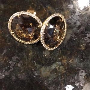 Brown Kate Spade earrings surrounded by crystals